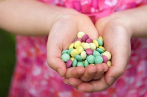 A child hands full of Little Gems