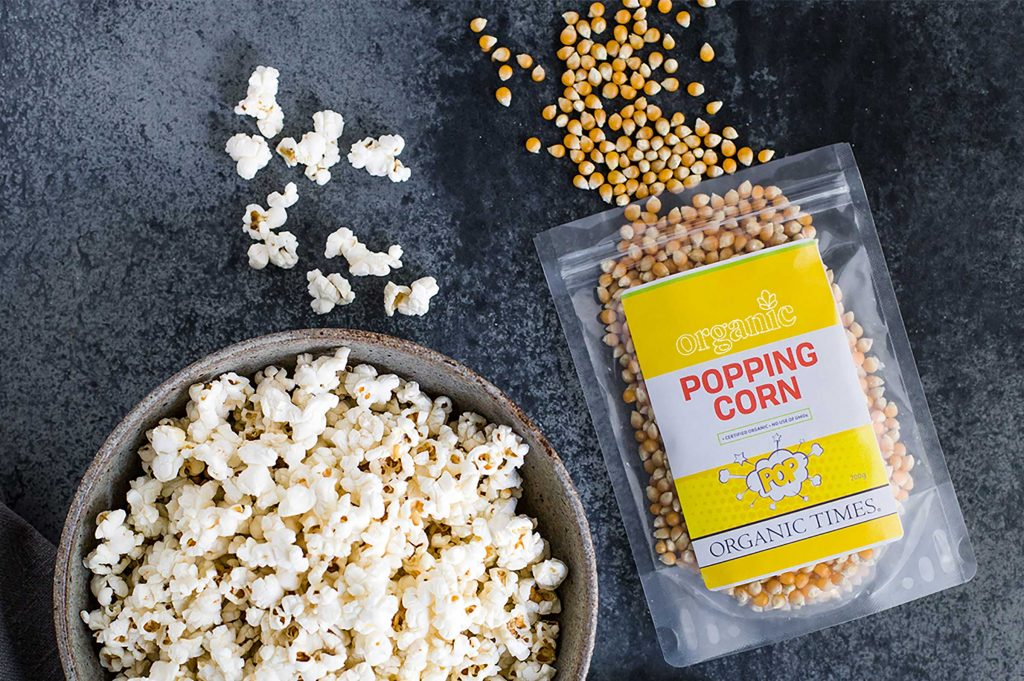 A bag and bowl of Organic Times popcorn kernels