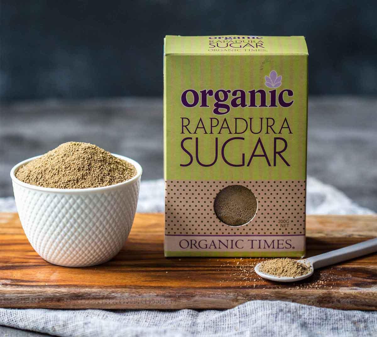A bowl and box of Organic Times Rapadura Sugar